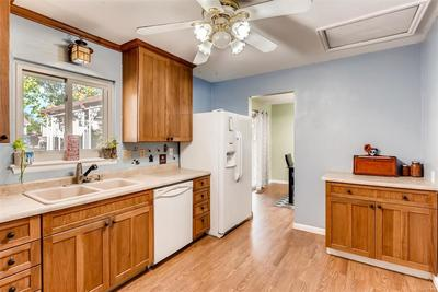 Kitchen is adjacent to the formal dining and the large back deck.