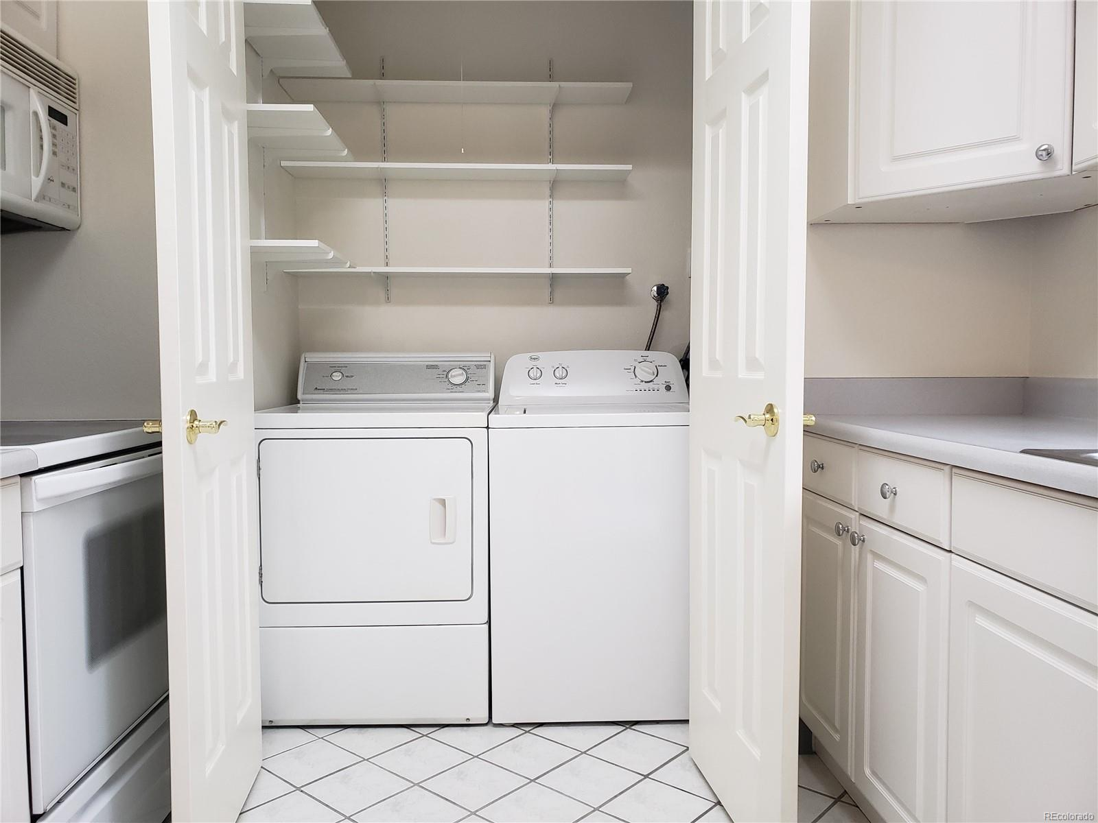laundry and pantry area in the kitchen/ washer dryer included