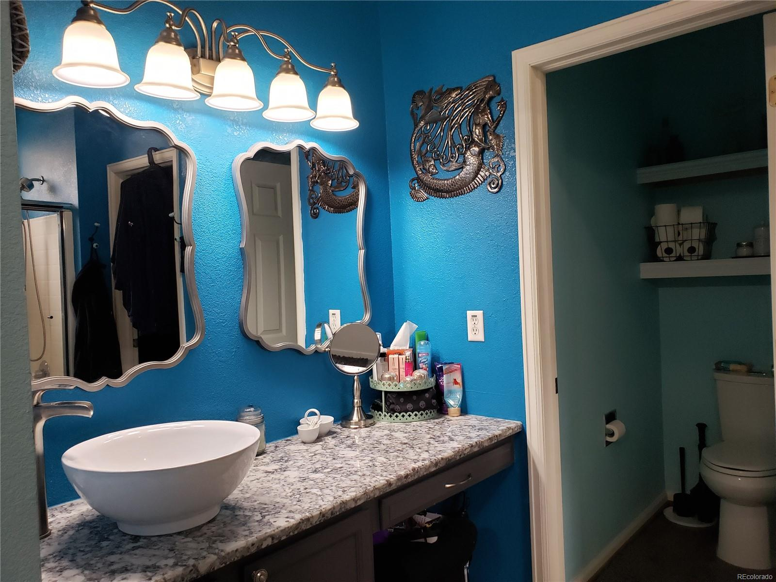 Master bath, new Vessel sink, new faucet,  granite countertops, new light fixtures and new mirrors.