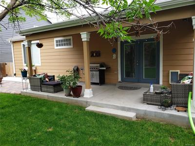 Beautifully done landscaping.  Mature trees,  large covered patio