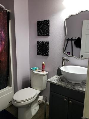 Main bath, full bath new vessel  sink and vanity., faucet, toilet and  new mirror.
