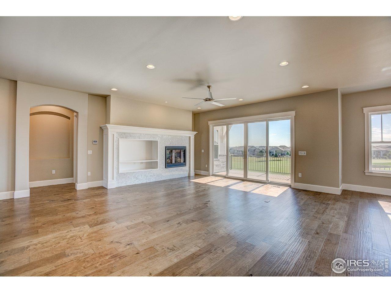 Open living room w/ hardwood floors