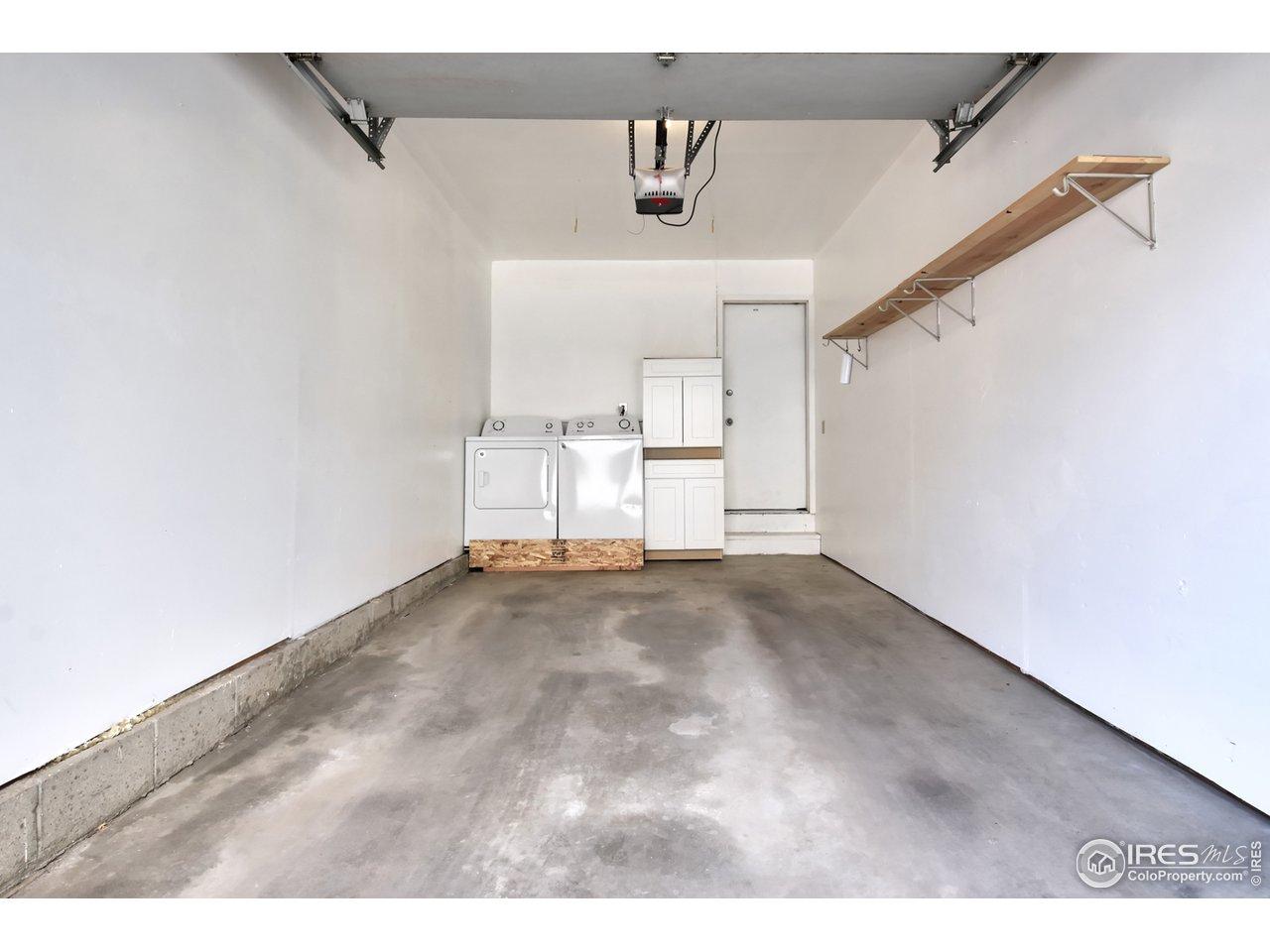 Garage, washer/dryer and storage cabinet