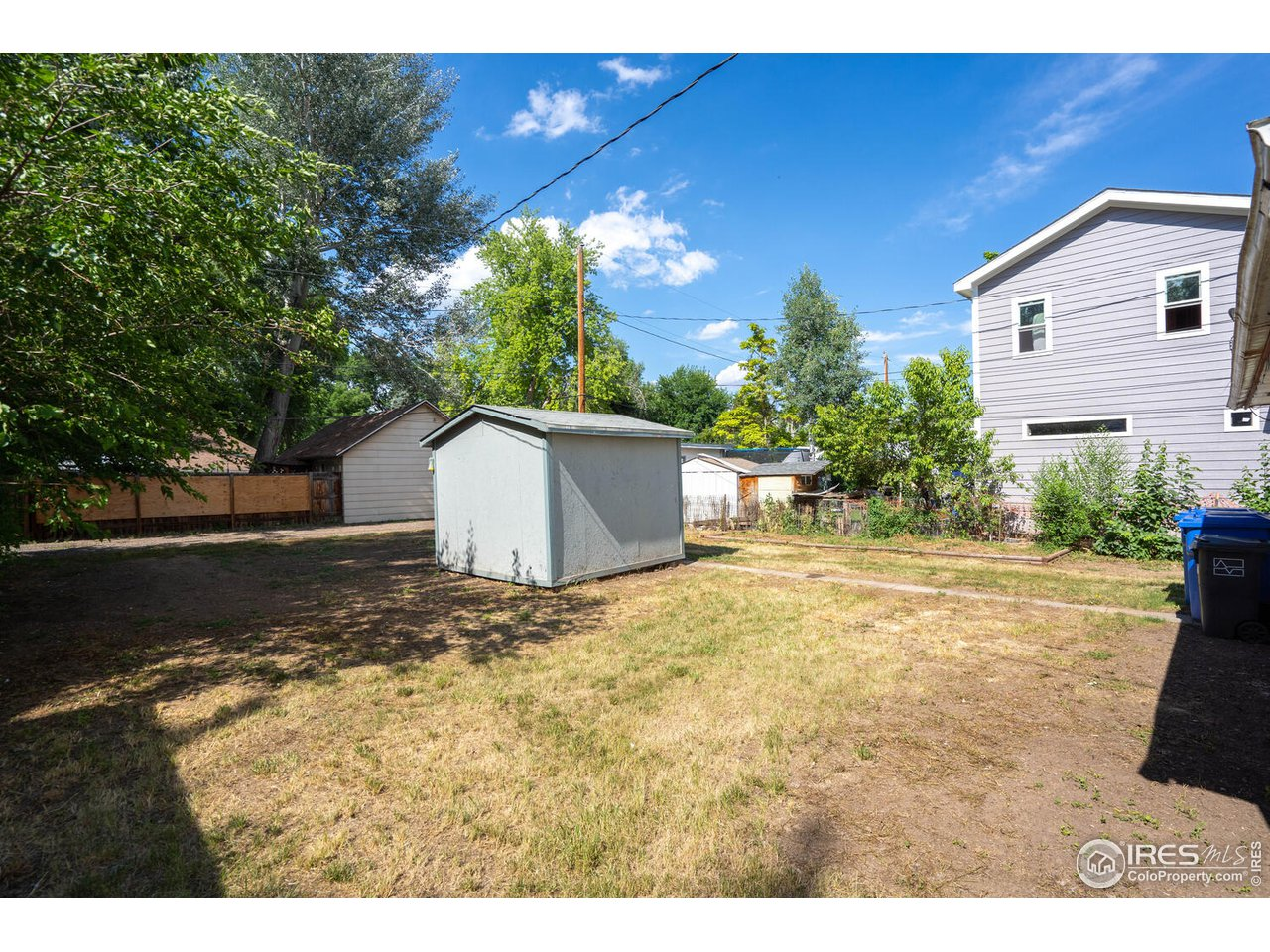 This quaint bungalow is situated on a deep lot with alley access and two storage sheds.