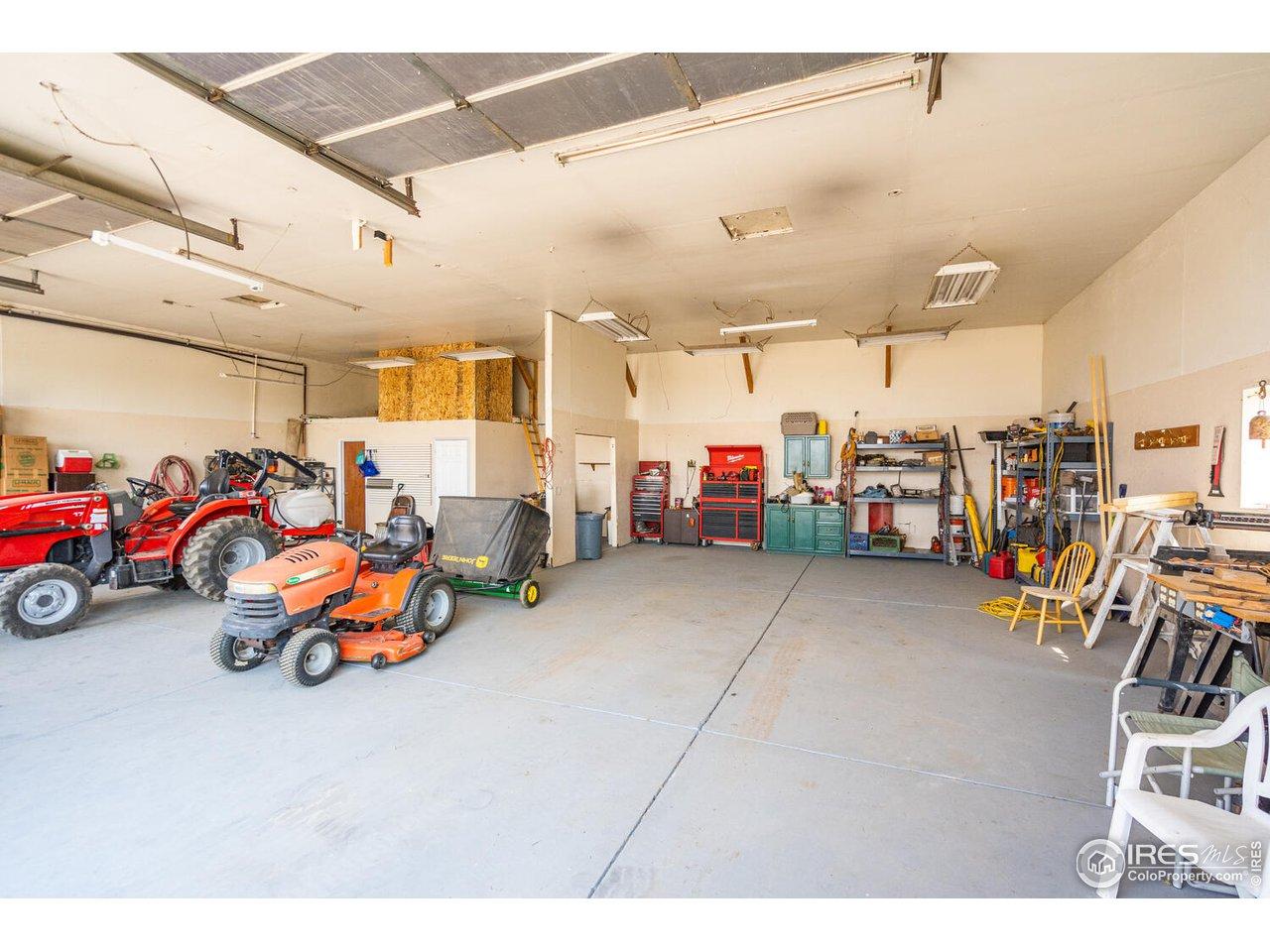 2 heaters, 3 overhead doors, concrete flooring.