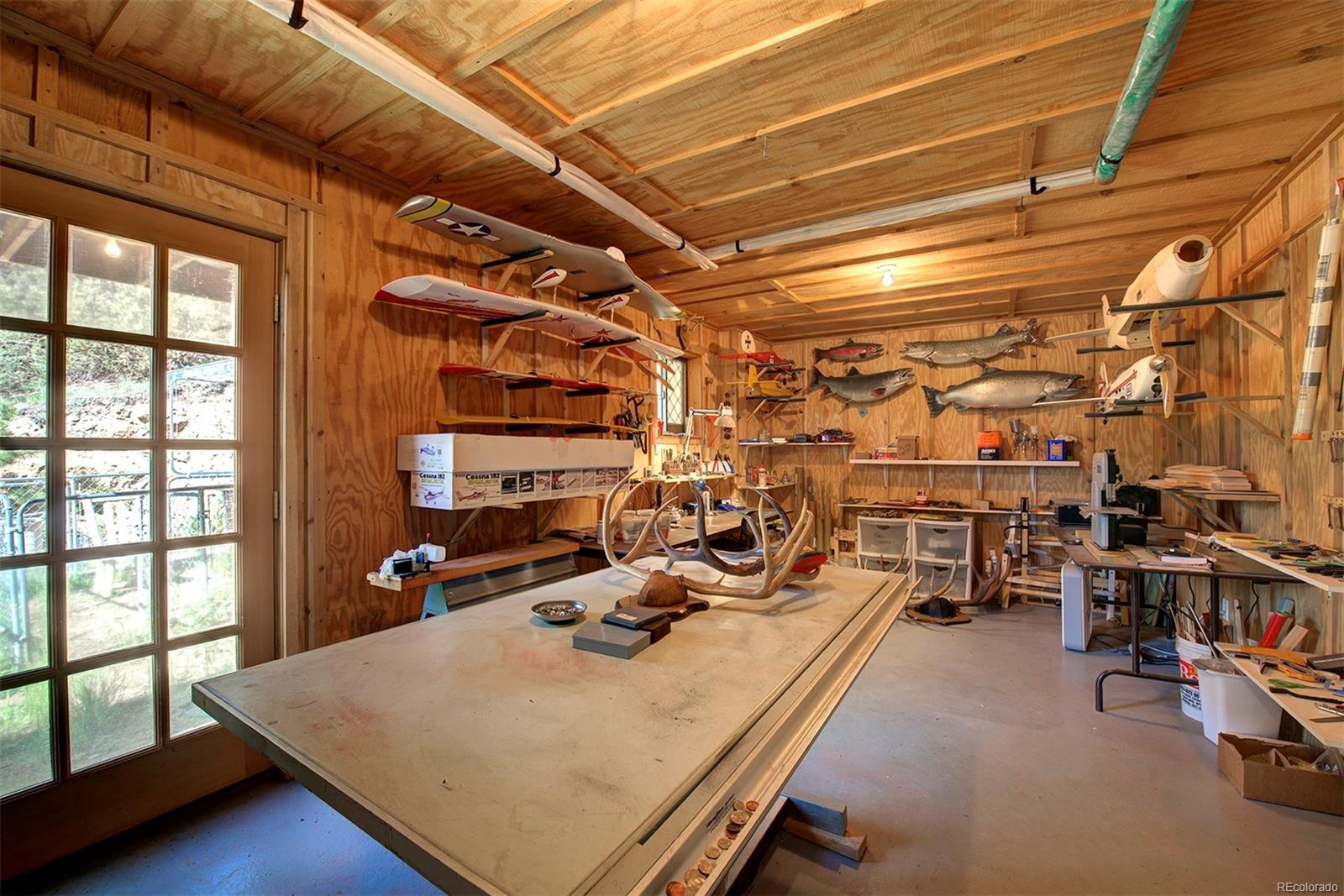 Hobby room, workshop, tack room of the barn. Has an air filtration system installed. The possibilities are endless!