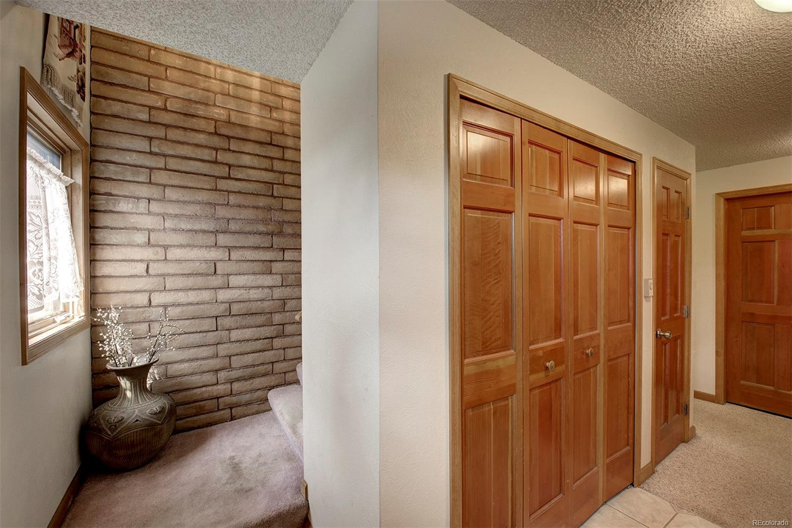 Lower level family room with bonus room and wood burning fireplace.