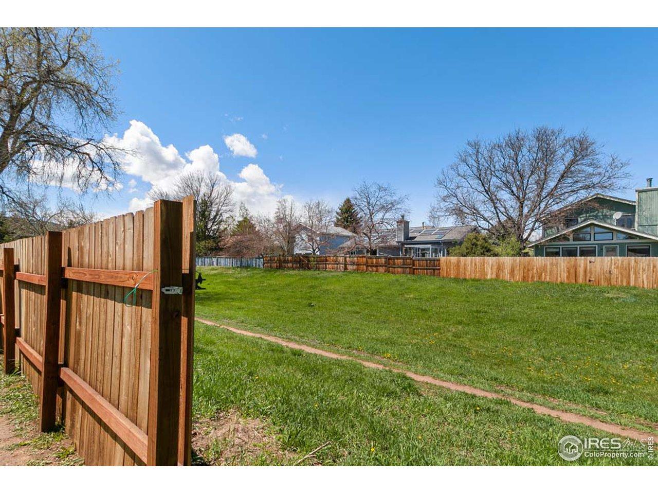 Gate adjoining green space