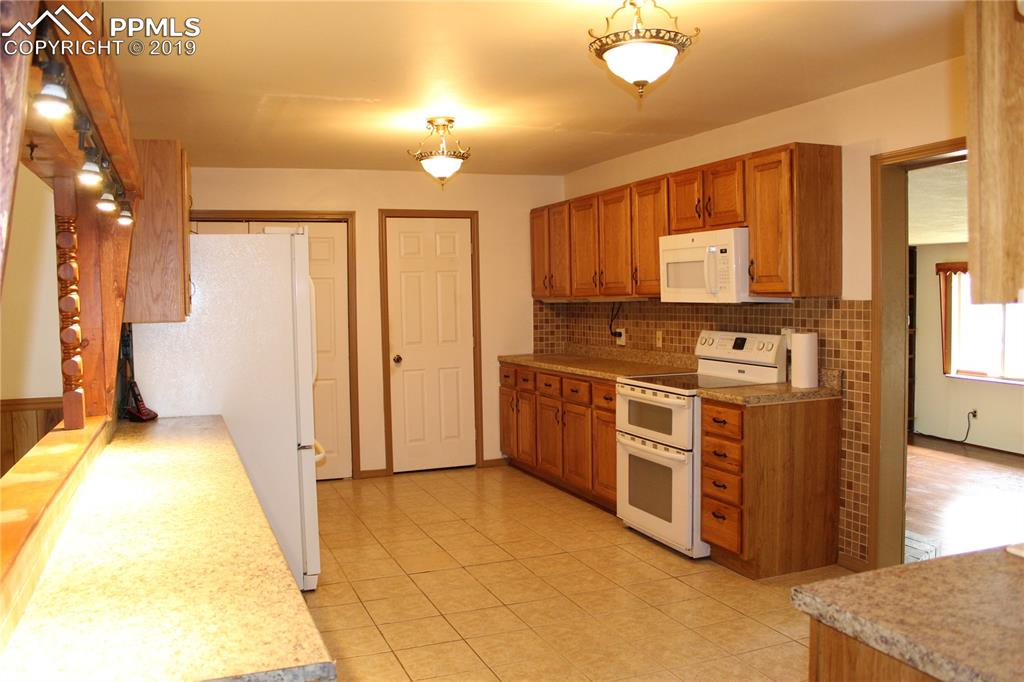 Large Kitchen with plenty of counter space and cabinets.