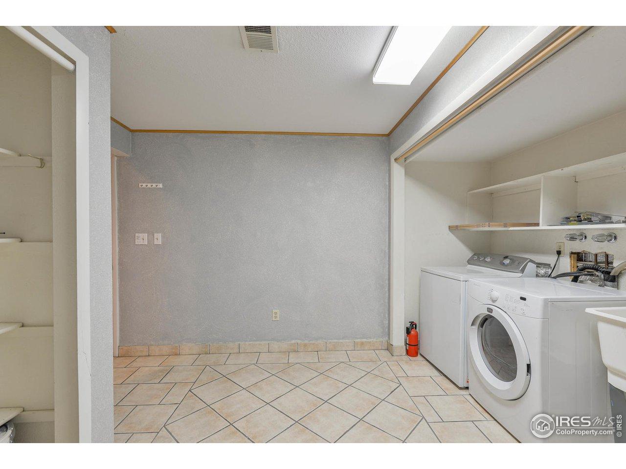 Large laundry off garage w storage & sink