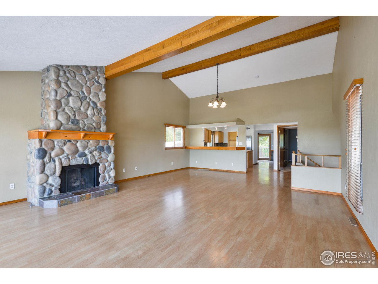Stone fireplace and beamed ceiling
