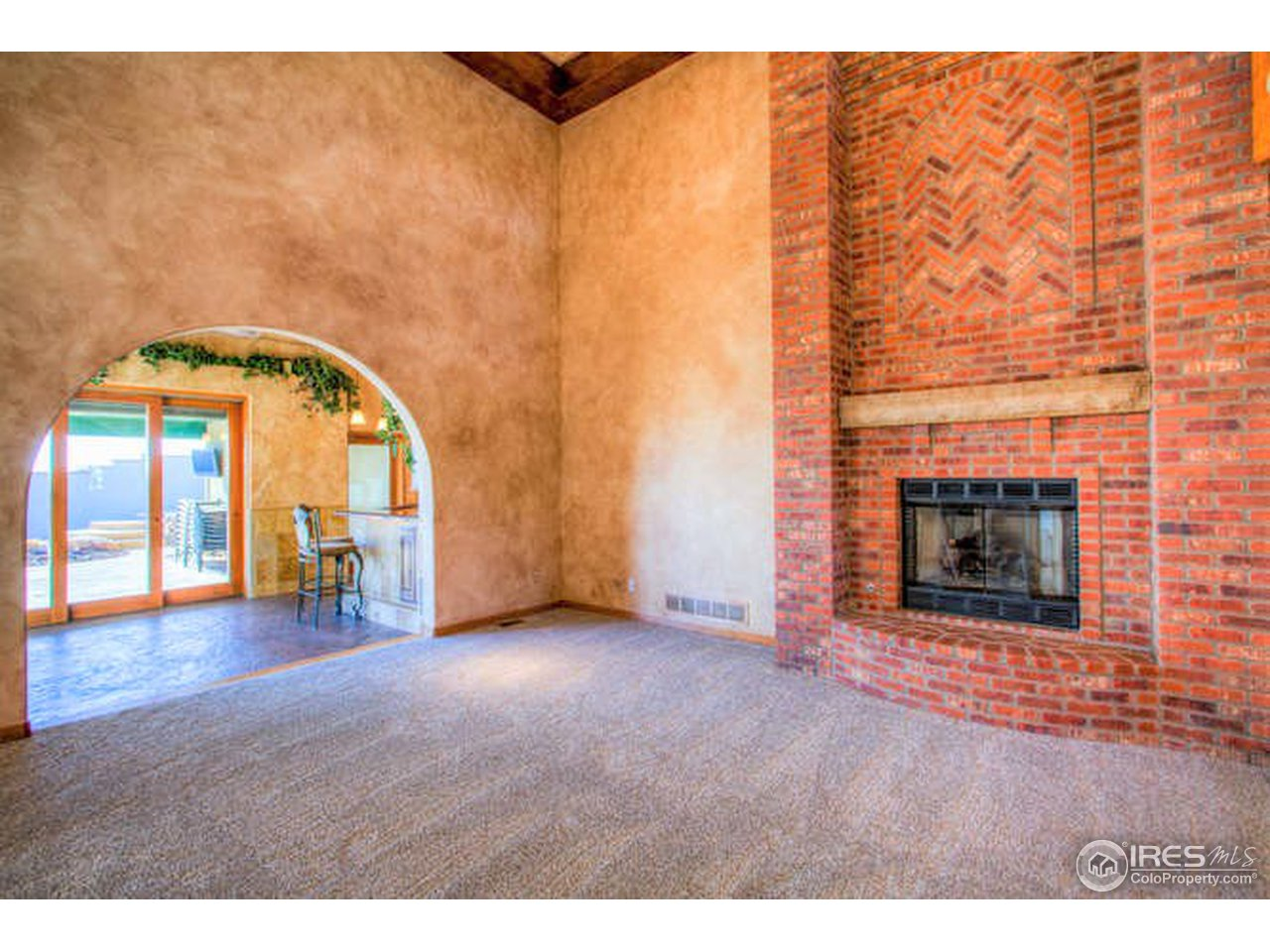 Grand floor to ceiling brick fireplace