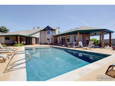 Backyard has double sided fireplace, hot tub, pool