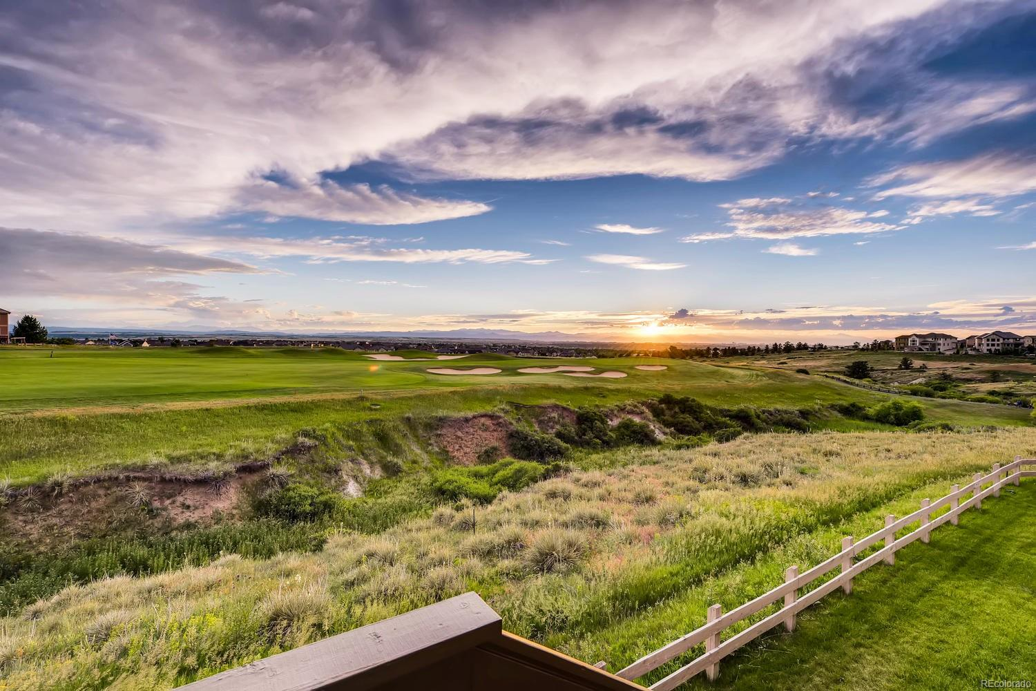 15th Hole of Black Bear Golf Course, City and Expansive Mountain Views are Visible from Both Levels.