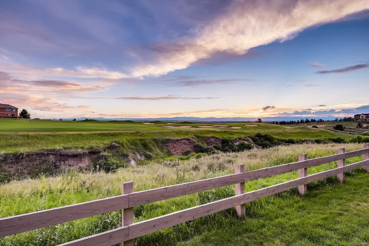 The impressive unobstructed golf course, city and expansive mountain views are visible from both levels.
