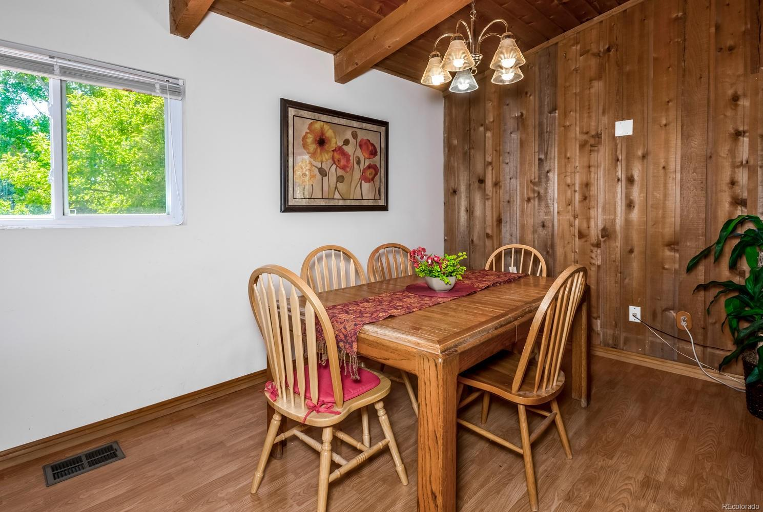 Dining Room with laminate wood flooring
