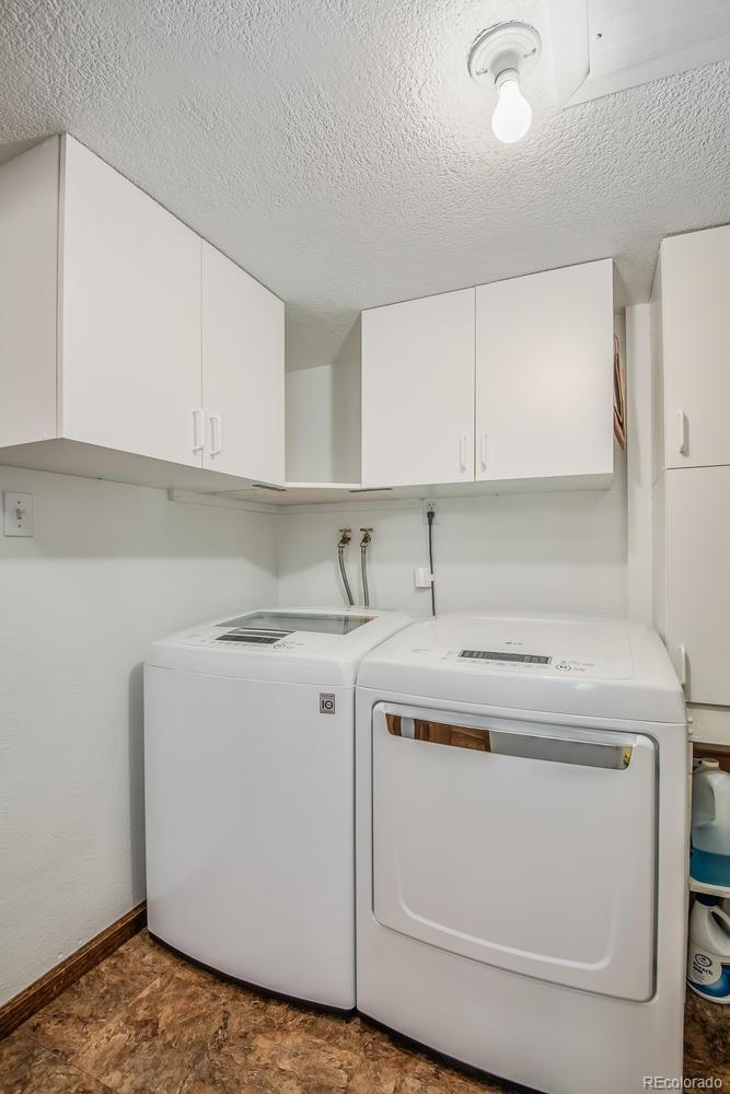 Laundry Room with full-sized Washer and Dryer included