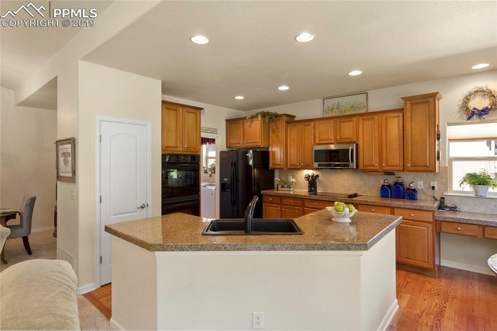 Built-in pantry, double ovens, refrigerator and new microwave included.