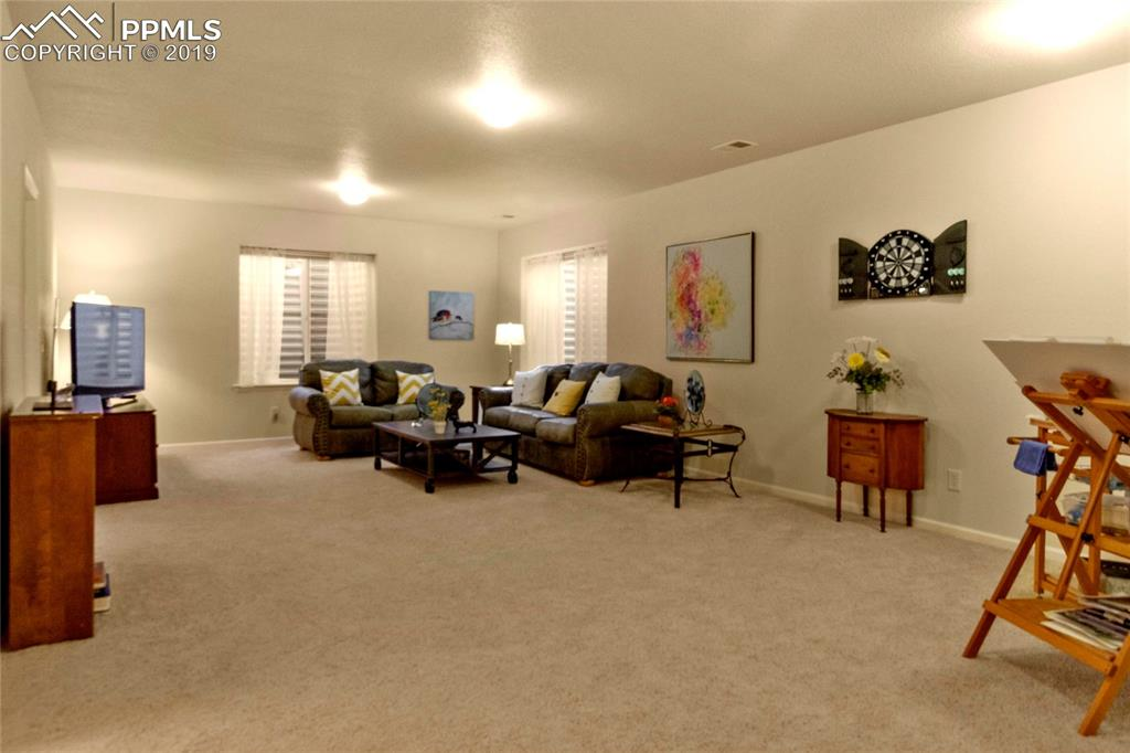 Huge downstairs family room with 9' ceilings.