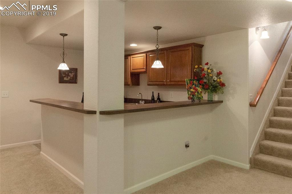 Great full-size bar area with mini fridge and sink.