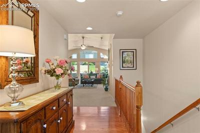 Inviting entry with gleaming hardwood floors.
