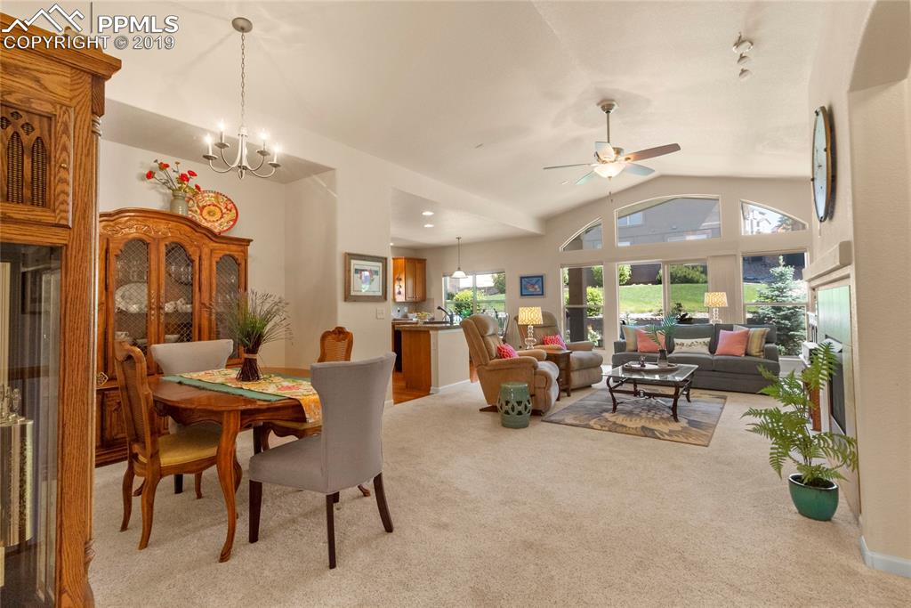 Generous and open concept dining, living room with vaulted ceiling and lots of windows.