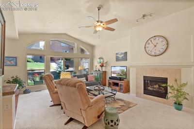 Ceiling fan, gas fireplace and walk-out slider to covered patio.
