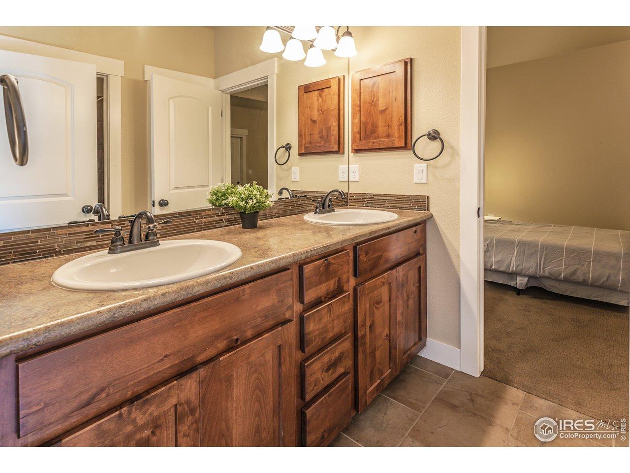 Twin sinks in shared full bathroom upstairs