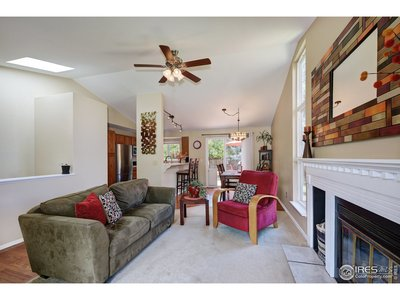 Large living room with vaulted ceiling, skylight