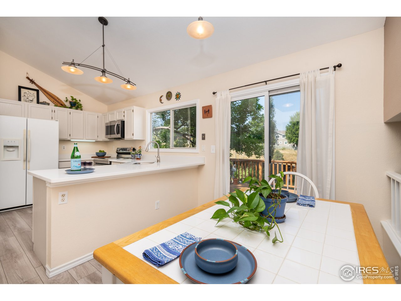 Eat-in kitchen with slider to private backyard