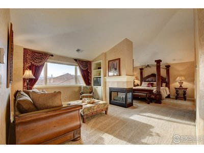Master suite with fireplace and foothills views
