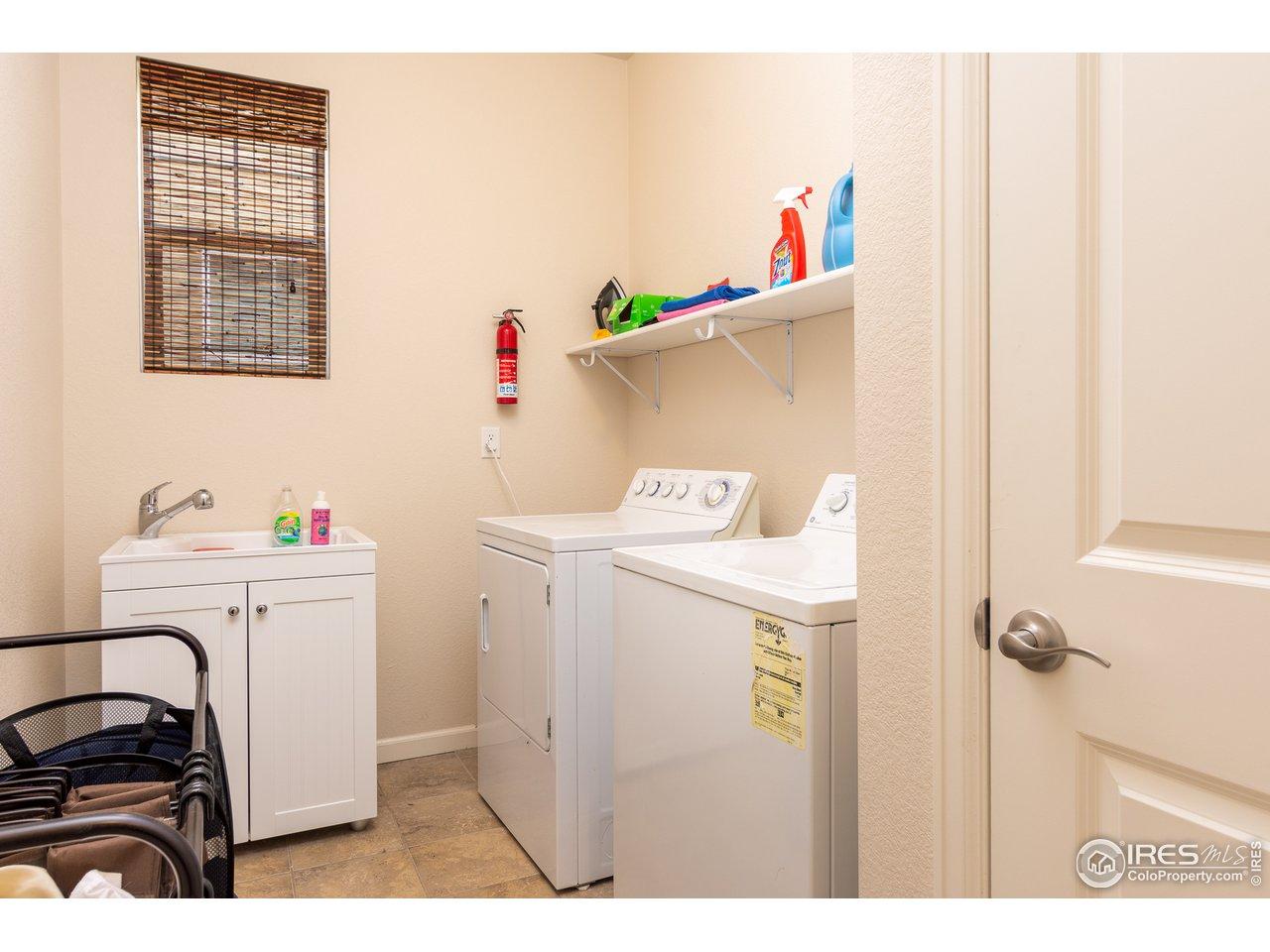 Main level laundry with tub
