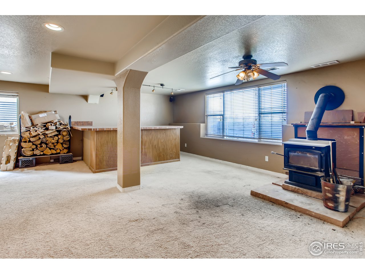 Recreation Room with Wet Bar and Wood Burning Stove