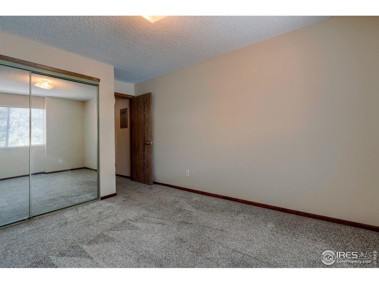 Large closet w/ mirrored doors