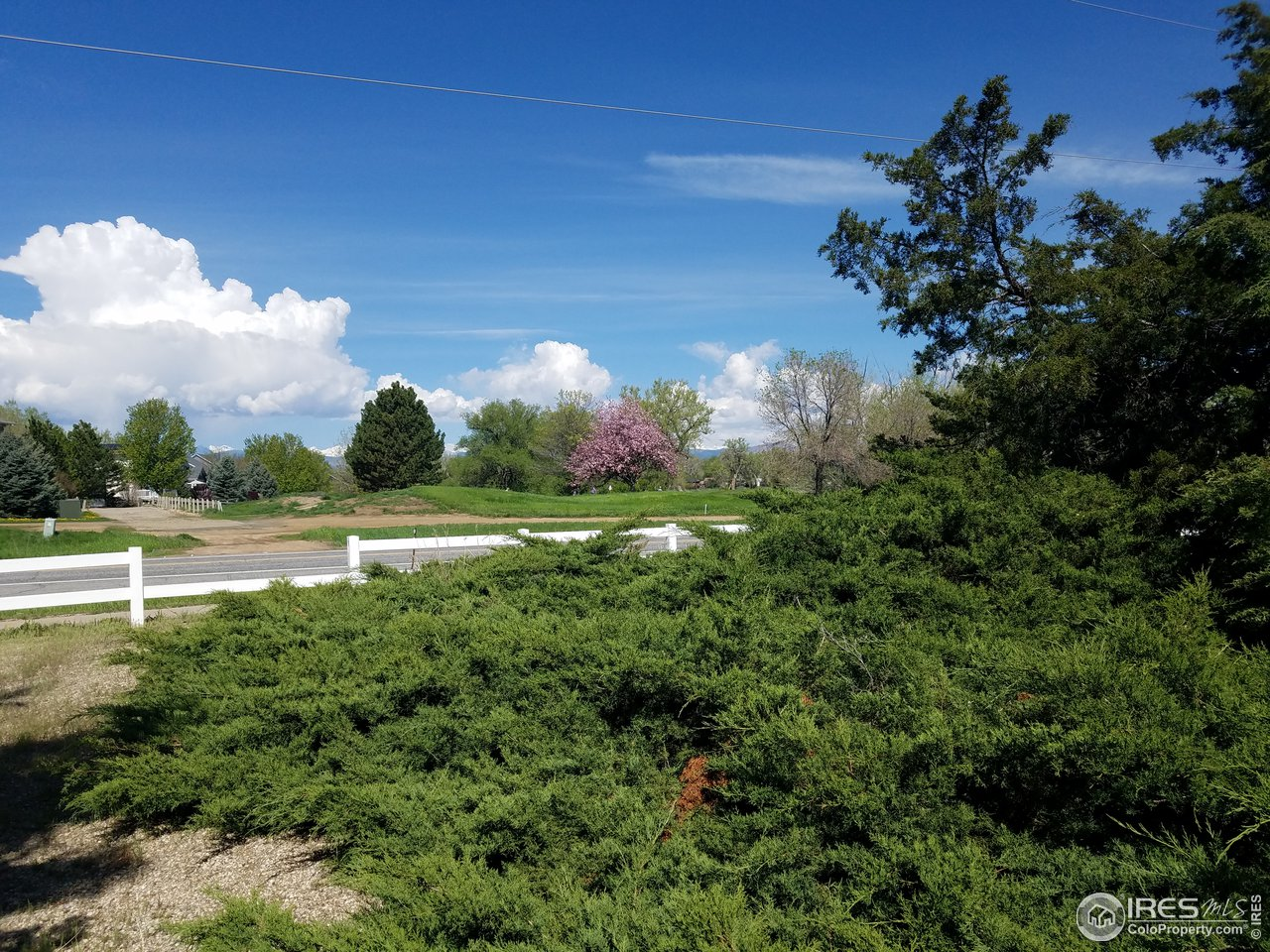 back range views from lot across 95th st overlooking golf course