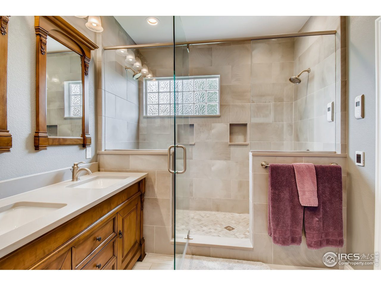 Master bath dual vanity and custom shower, heated floors.