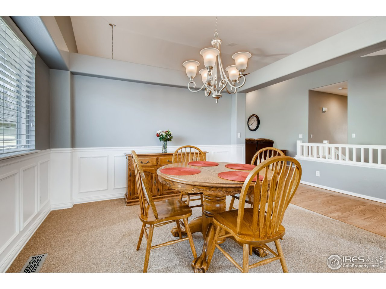 Dining room with custom wainscot and new carpet