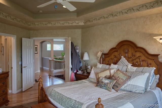 Master bedroom, coffered ceiling, double doors to upper hallway