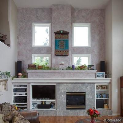 Television, components, fireplace in the Great Room