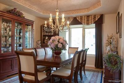 Dining room with coffered ceiling and gorgeous chandelier