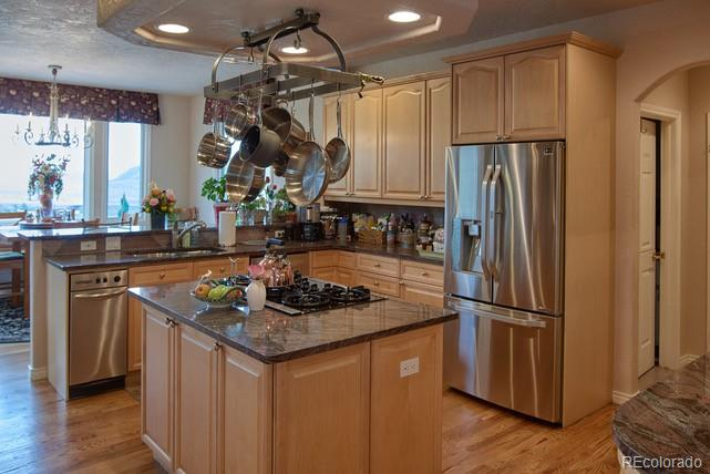 Kitchen island with gas cooktop and downdraft vent